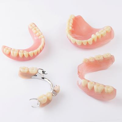 Several types of dentures in Springfield on white background